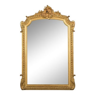 Louis Philippe gold leafed frame enclosing the original mirror glass from France c.1885. (37″w x 57″h)