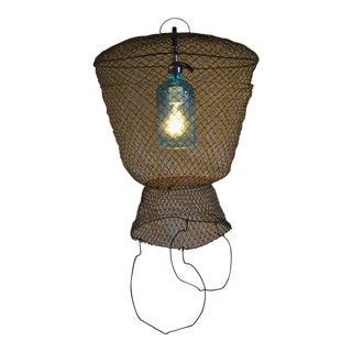 Pendant Light from Seltzer Bottle Suspended in French, Steel Mesh Fish Basket