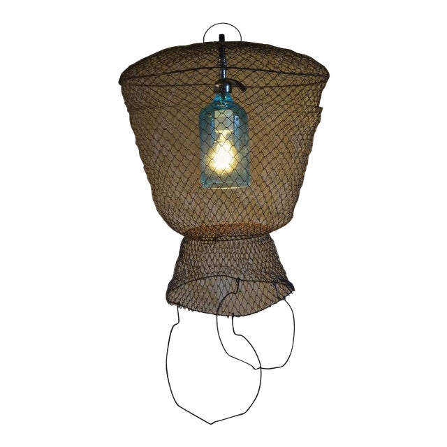 Image of Pendant Light from Seltzer Bottle Suspended in French, Steel Mesh Fish Basket