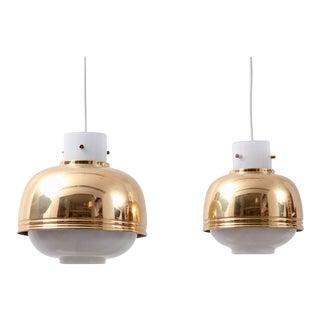 Pair of Brass and Glass Pendant Lamp by Glashütte Limburg