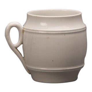 Small barrel shaped cup with circular handle from France c.1890