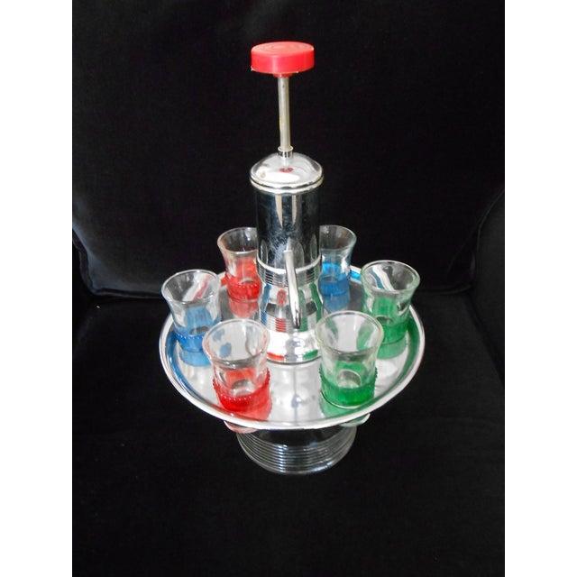 Image of Vintage Pump Decanter With Shot Glasses