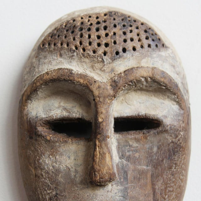 Image of Carved Wooden Lega Origal Mask