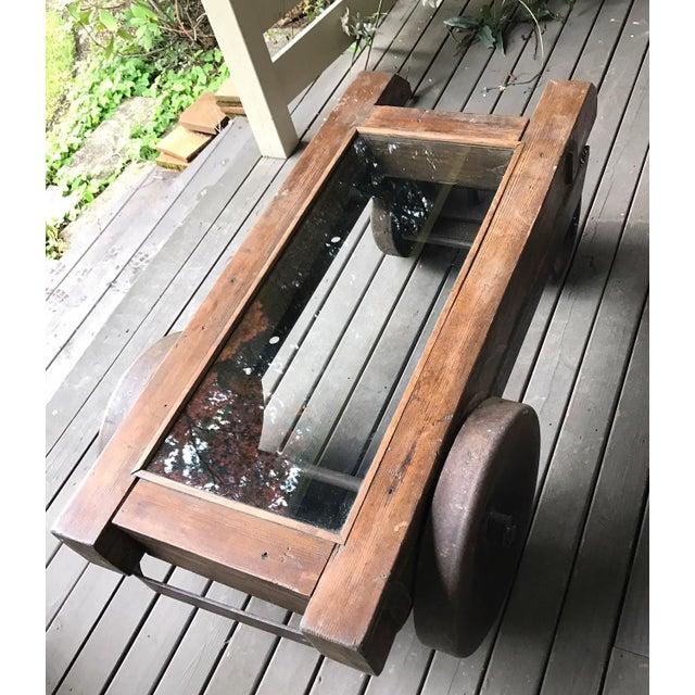 Repurposed vintage iron wood mine cart coffee table