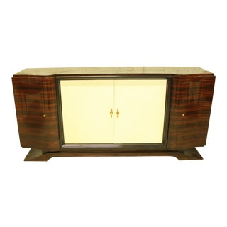 Classic French Art Deco Macassar Sideboard or Bar With Parchment Center Door By Maurice Rinck , Circa 1940s.