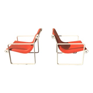 Knoll Iconic Orange Shell Lounge Chairs - A Pair