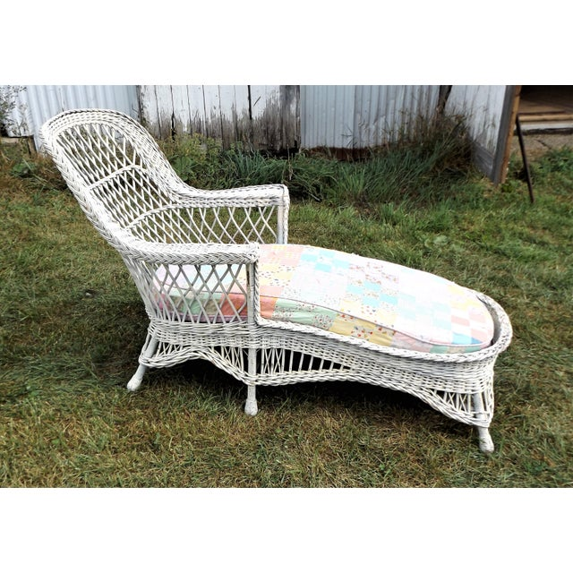 Vintage wicker chaise lounge with cushion chairish for Antique wicker chaise lounge