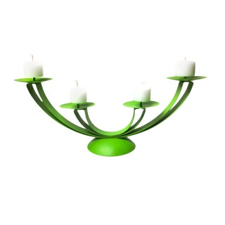Vintage totally groovy bright green metal four tier candelabra.