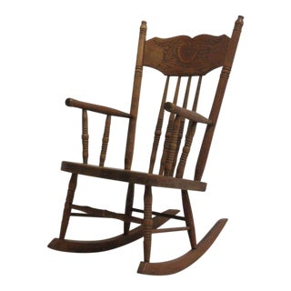 Antique Child's Carved Rocking Chair