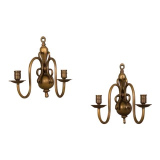 A pair of two arm sconces from Holland c. 1920 retaining their original dark bronze finish.