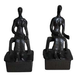 Man Sitting on Bench Bookends - A Pair