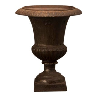A cast iron garden urn from France c. 1890 in the form of an antique Italian original having a lovely diminutive scale
