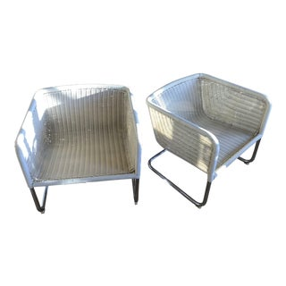 White Wicker Cantilevered Chairs - A Pair