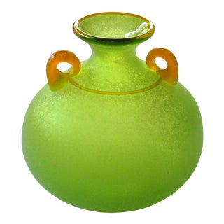 A good quality and vibrant Murano signed Franco Moretti acid green scavo vase with orange handles and trailing; with etched signature underneath