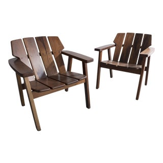 Pair of slatted rosewood lounge chairs by Sergio Rodrigues, Brazil, 1960s.
