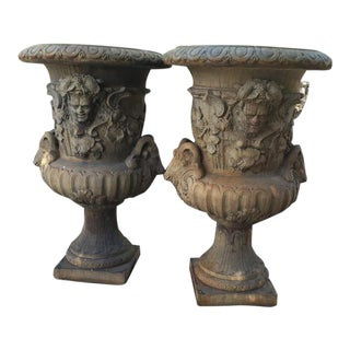 A Pair of Large European Cast Garden Urns with Mascarons, Rams Heads, and Grape Vines