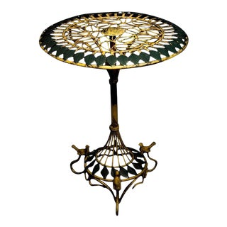 Intricate Neapolitan Art Nouveau round ironwork table with birds and leaf motif, 20th century