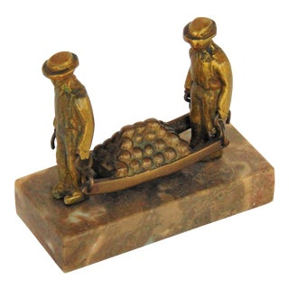 Antique Men Carrying Cannonballs Paperweight