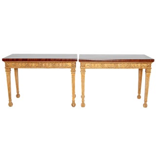 A PAIR OF GEORGE III STYLE GILTWOOD CONSOLE TABLES