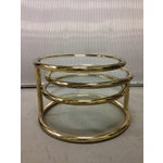 Image of Mid-Century Tiered Brass Swivel Coffee Table