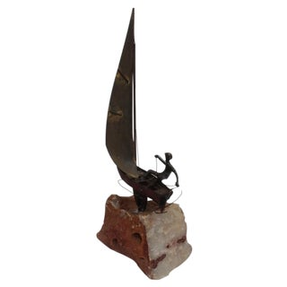Bronze and Stone Sculpture of Boy on a Sailboat