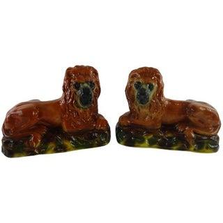 Staffordshire Recumbent Lion Figures - A Pair