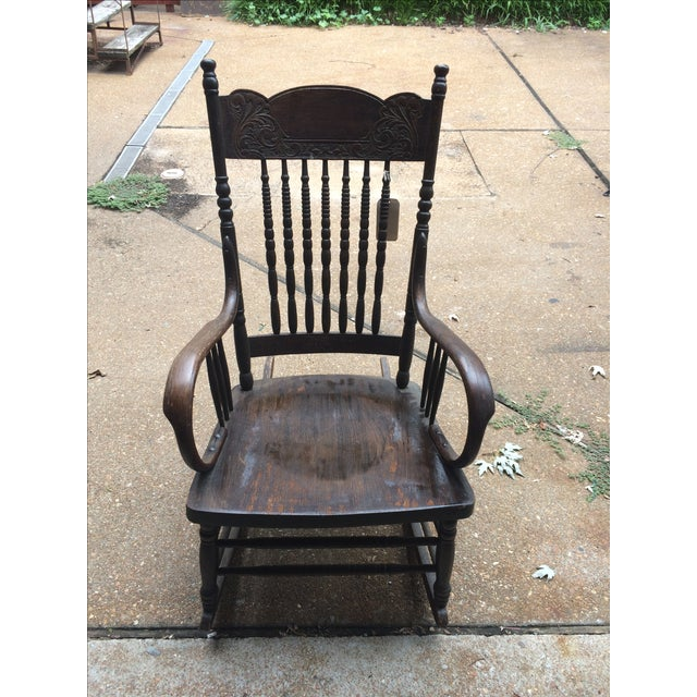 Beautiful dark wood spindle turned rocking chair with carved designs ...