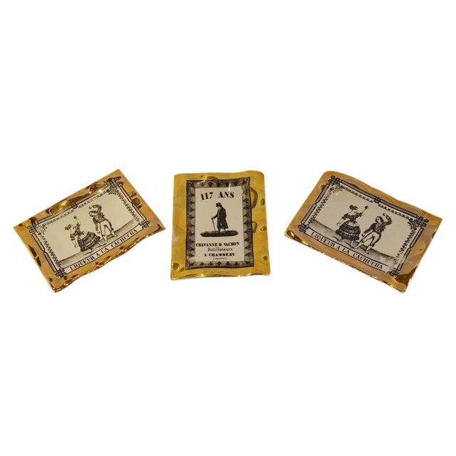 Image of Fornasetti Italian Advertising Label Set of Three Porcelain Pin Trays