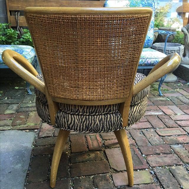 Image of Zebra Upholstered Cane Back Swivel Chair