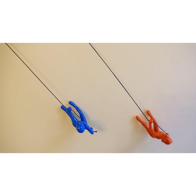 Image of Blue & Orange Climbing Man Wall