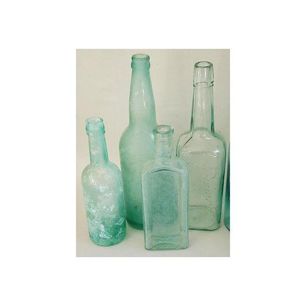 Image of Antique Teal & Blue Glass Bottles - Set of 10