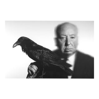 Alfred Hitchcock holding a bird 1958
