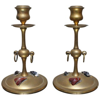 A Pair of Bronze Candlesticks with Carved Stone Moths.