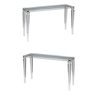 An elegant pair of perspex console tables