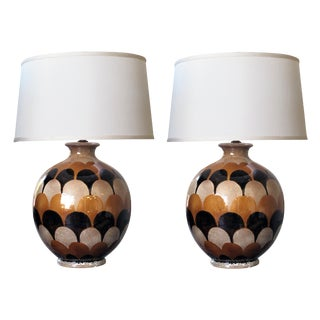 A bold pair of Italian 1970's handmade ovoid-shaped ceramic lamps with imbricating glaze