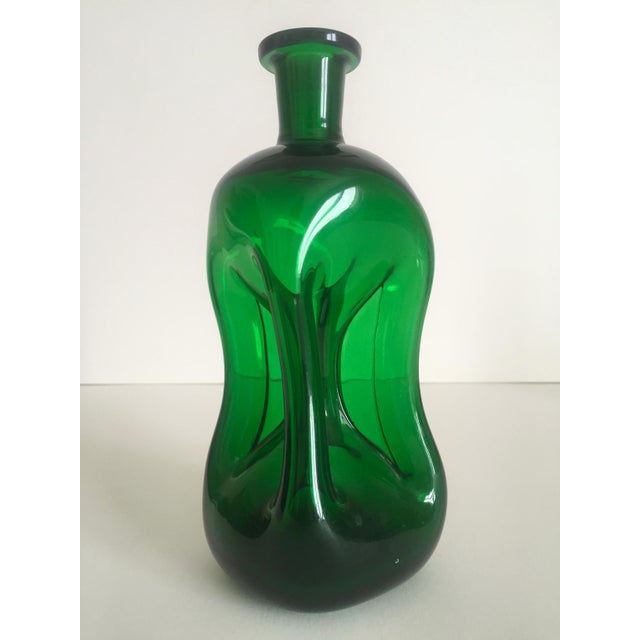Image of Vintage Mid-Century Modern Collected Green Glass Bottles - Set of 4