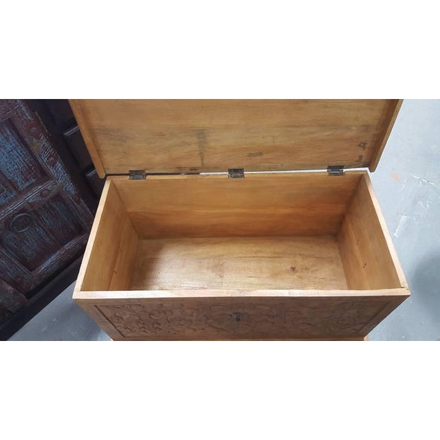 Image of Carved Wooden Chest With Wheels