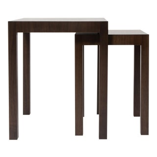 Two bespoke walnut nesting tables with extra freestanding table