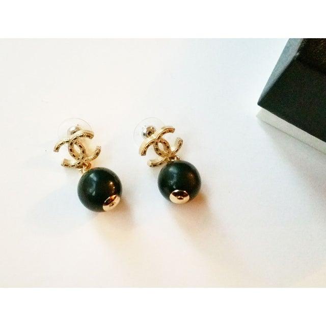 Image of Chanel Gold CC Black Stone Dangle Pierced Earrings