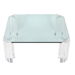 RECTANGULAR 1970S GLASS COCKTAIL TABLE WITH CLIPPED CORNERS AND LUCITE SUPPORTS