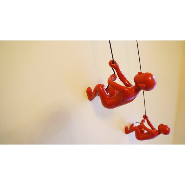 Image of Red Position 3 Climbing Man Wall Art - Set of 4