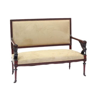 Empire Style Carved Settee with Ebonized Accents