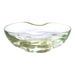 A large and thickly-modeled Swedish 1960's pale green art glass oblong bowl