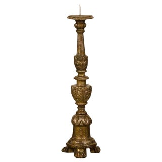 A grand scale gilded wood candlestand with a three leg base supporting a circular column from Italy c. 1850.