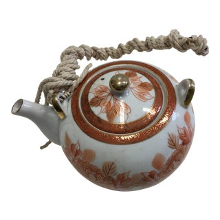 East Asian Porcelain Teapot with Rope Handle