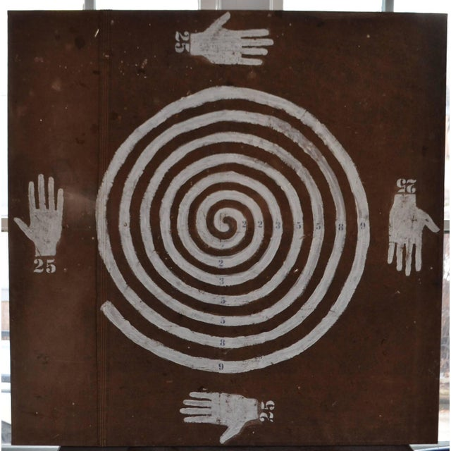 Image of Painting on Weathered, Brown Canvas Tarp