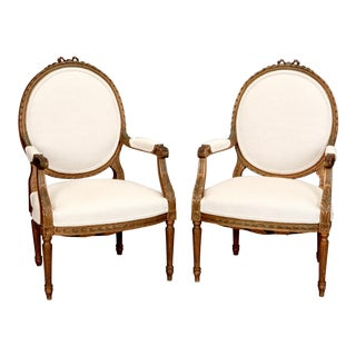 Louis XVI Oval Back Gilded Frame Fauteuils - A Pair