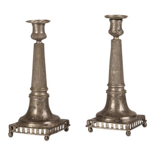 A pair of unusual square base pewter column candlesticks from France c.1890.