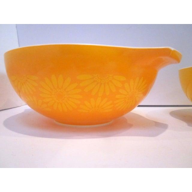 Image of Mid-Century Pyrex Yellow Orange Nesting Bowls