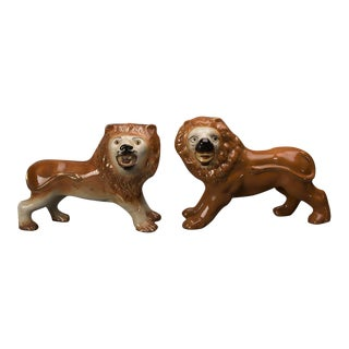 A pair of Staffordshire lions standing on fully articulated legs from England c. 1870 finished on all sides in order to be viewed from any direction